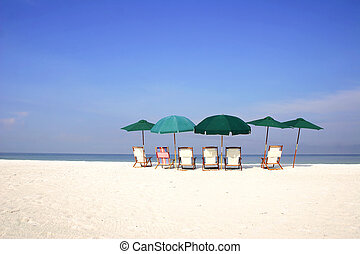 Beach Umbrellas - Group of umbrellas and deckchairs on the...