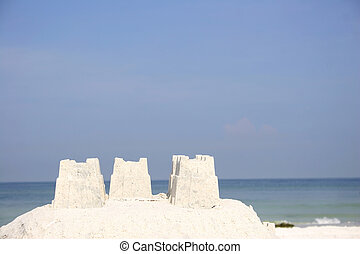 Sandcastle and beach