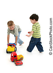 Toddler Boy Playing - Two toddler boys running around with...