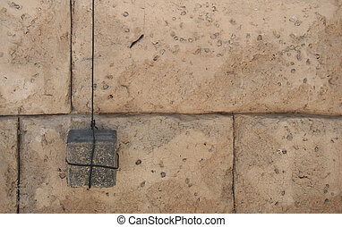 Plumb Line on a Stone Wall