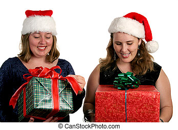 Opening Christmas Gifts - Two women opening their Christmas...