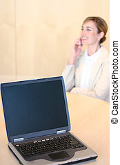 Commmunicating - Young business woman talks on cellphone...