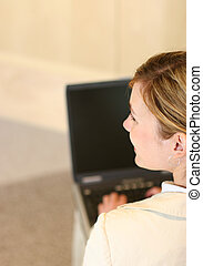 casual worker - Young businesswoman works on laptop