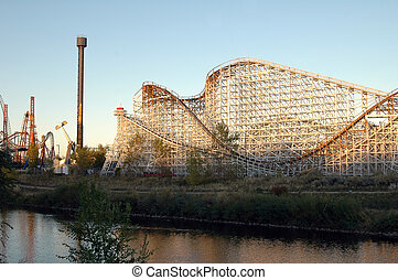 Amusement Park - An amusement park glows amber in the...