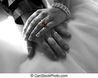 wedding hands - detail of newlyweds hands in bw w rings left...