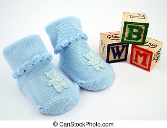 Blocks and Booties - A pair of blue booties beside some...