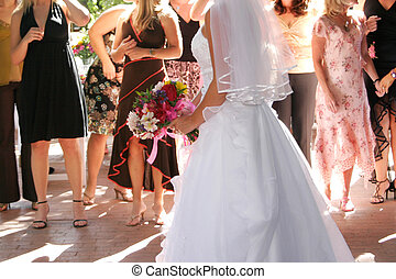 bride boquest toss - a bride preparing to throw a boquet