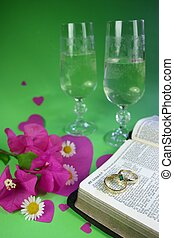 Wedding Rings - Wedding rings on open bible, with hearts,...