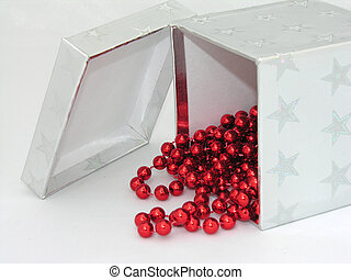 Silver box red beads - A silver gift box with red christmas...