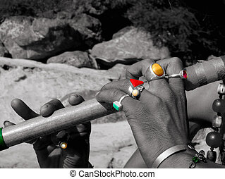 Flute and colour rings - Man playing the flute in India on...