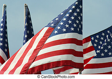 Four US Flags - four US flags in breeze