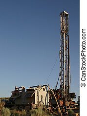drilling rig - a drilling rig and pumping truck sit on site