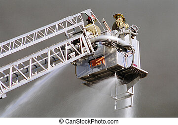 Firemen at work - Close-up of firemen with hoses, fighting a...
