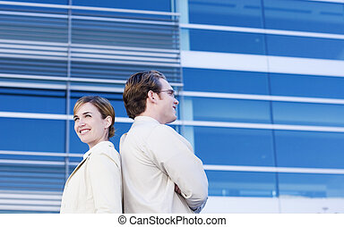 back to back - Businessman and woman back to back