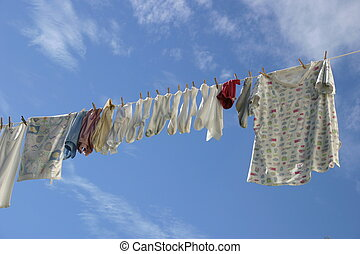Fresh Laundry - Clean laundry hanging ona line in a blue...