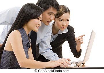 Business Team 8 - An asian business team looking at a laptop...