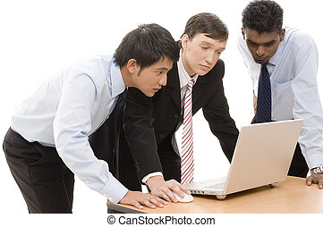 Business Team 9 - Three businessmen confer around a laptop...
