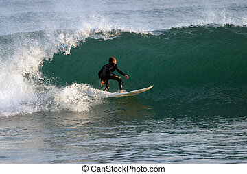 Surfrider - Surfer riding a wave in Southern California.
