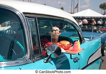 Classic Fast Food - Classic car with food tray attached to...