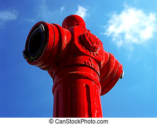 Fire hydrant - Red fire hydrant on a blue sky with white...