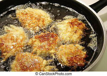 Frying Latkes For Hanukah - Potato latkes for Hanukah frying...