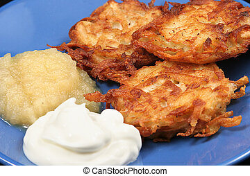 Potato Latkes Closeup - Delicious potato latkes for Hanukah,...