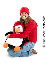 Young Woman Holding Toy Pengquin