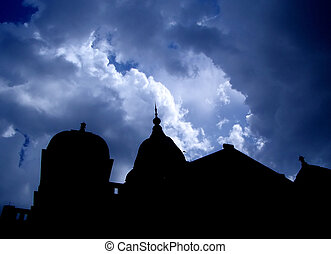 Gothic Horror Sky - A gothic mansion is silhouetted against...