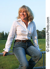Country Western Woman 1 - A beautiful, mature woman sitting...