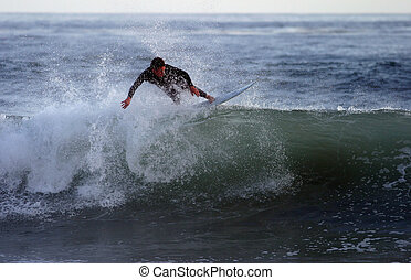 Surfer Rides the Crest - An unknown surfer rides the crest...