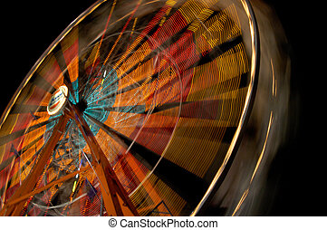 Ferris Wheel - A ferris wheel at night with light trails...