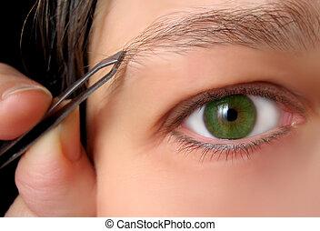 tweezing brows - tweezing eyebrows