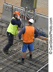 Men at work - Two men at a worksite