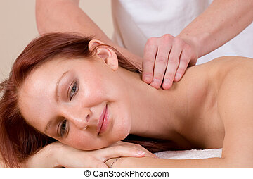massage #35 - Woman lying on massage table with the hands of...