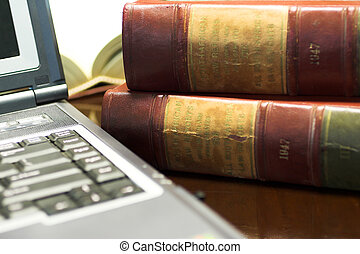 Legal books 29 - Laptop and Legal books on table - South...