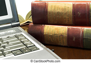 Legal books 30 - Laptop and Legal books on table - South...