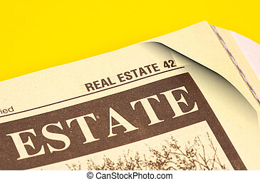 Real Estate - Phonebook Open Up To The Real Estate Section