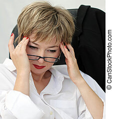 Difficult decission - Businesswoman in eyeglasses