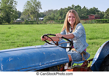 Girl Driving Tractor - A beautiful farmer's daughter driving...