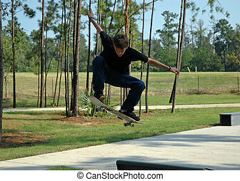 Soaring Teen Skater - A teenaged boy soars through the air...