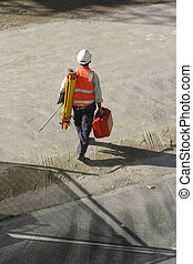 Surveyor - a surveyor going to work. Surveyors provide data...