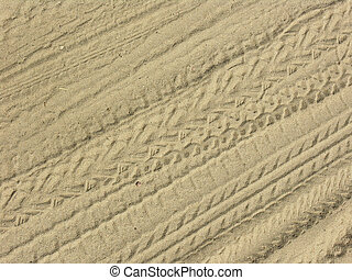 Tracks in sand - Multiple bicycle, car tracks in yellow sand
