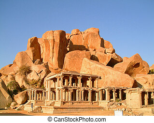 temple boulder - indian temple ruin infront of massive rock...