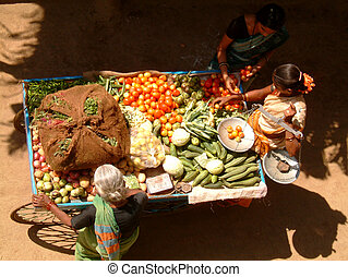 vegetable market - lady selling her vegetables on her...