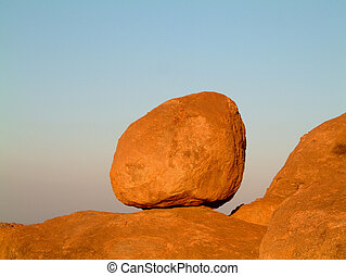 granite boulder sky - huge granite boulder perched on rocks...