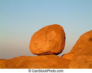 granite boulder sky - huge granite boulder perched on rocks...