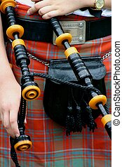 Scottish Kilt and Pi - Closeup of kilt, sporan and bagpipes...