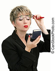 Finishing touch - Businesswoman checking her makeup