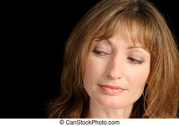 Thinking It Over - A beautiful mature woman with a...