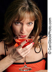 Cosmo Girl Takes A Sip - A beautiful woman in red sipping a...